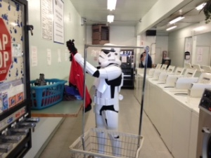 Item 4 IMAGE: A stormtrooper at a laundry mat folding clothes.