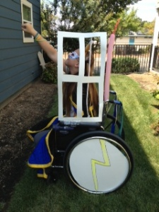 "Item 20- IMAGE: Retrofit a wheelchair and its owner to look like a powerful superhero in a ""Gishmobile."""