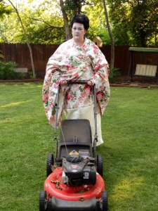 Item # 106- IMAGE. Let's see a fully dressed, face-painted geisha mowing the lawn.