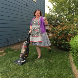 ITEM 139. IMAGE- Do your best 1950's June Cleaver impression and vacuum the lawn.